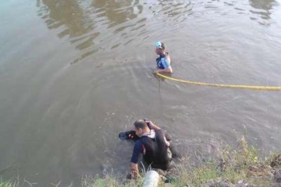 أب يلقي بنفسه وطفلتيه في النيل