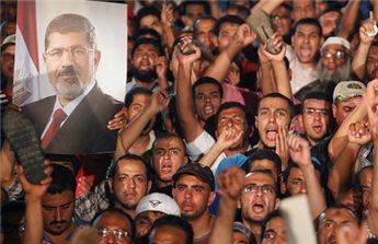 النظام يشعل النار بين أنصار مرسي بالخارج