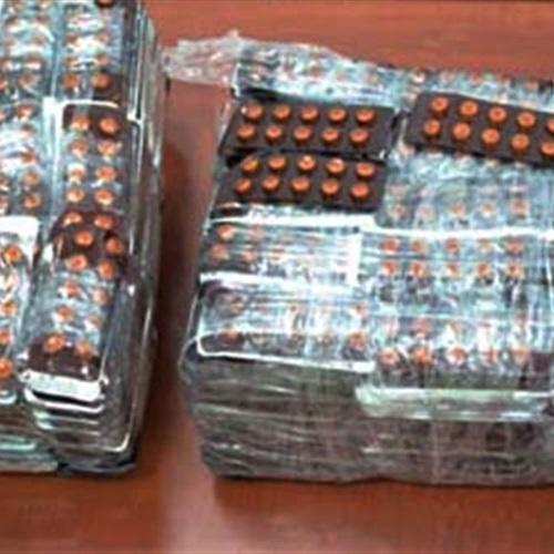ضبط أقراص مخدرة بحوزة مسافر إلى الصين